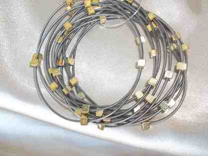 12 bands of funky and elegant! Bracelet - Silver and Gold Colored